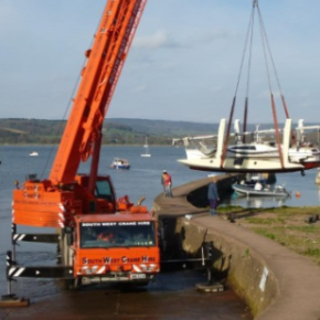 Annual Craning of moored boats from brook to shore