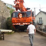 Craning in; precision needed for heavy lifting of boats
